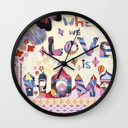 Where we love is home Wall Clock