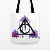 deathly hallows Tote Bags featuring The Deathly Hallows by AliceInWonderbookland