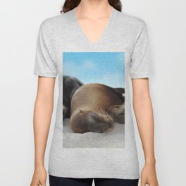 Sea lions family sleeping together on beach Unisex V-Neck