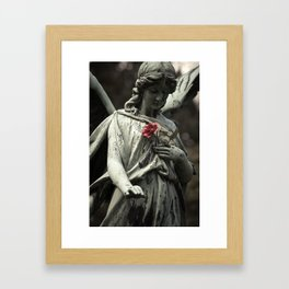 Angel with a rose Framed Art Print
