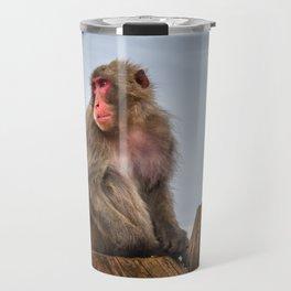Japanese macaque on a trunk, Iwatayama monkey park, Kyoto, Japan Travel Mug