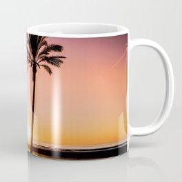 Orange bright sunset at the beach between palms Coffee Mug