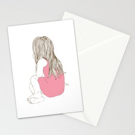 Little girl in a pink dress sitting Stationery Cards