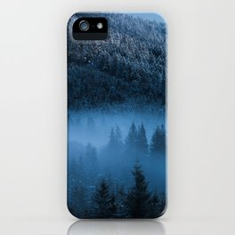 Magical fog over snowy spruce forest iPhone Case