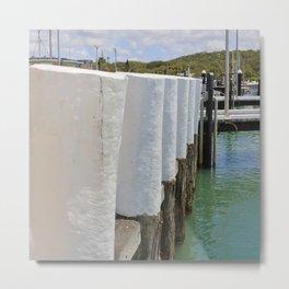 Gleaming white harbor bollards Metal Print