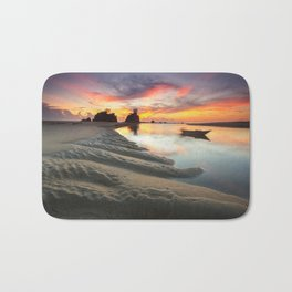 Canoe on the Water at Sunset Bath Mat