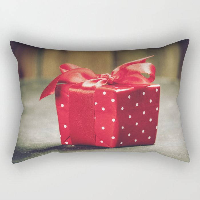 Valentine's Day concept. Gift with red bow on the wooden background Valentines gift box tied with a Rectangular Pillow