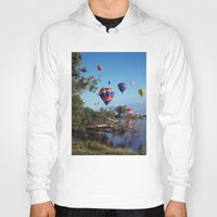 hot air balloons Hoodies featuring Hot air balloons over lake by Bruce Stanfield Photographer