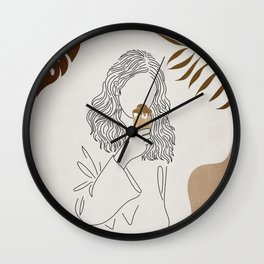 Woman standing eating ice cream at a park in the city. Wall Clock