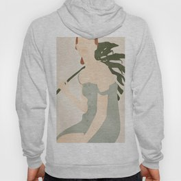 Holding the Monstera Leaf Hoody