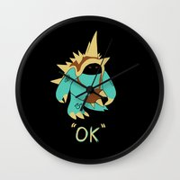 kim sy ok Wall Clocks featuring Ok by Yiannis