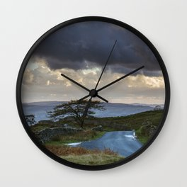 Tree beside remote mountain road at sunset. 'The struggle' to Kirkstone Pass. Lake District, UK. Wall Clock