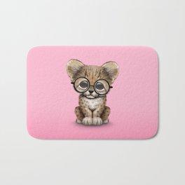 Cute Cheetah Cub Wearing Glasses on Pink Bath Mat