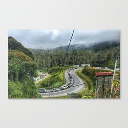 Cars flocking on the uphill road at Cameron Highlands Malaysia. Canvas Print