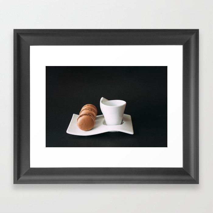Set of cup of coffee and macaroons against black background Gerahmter Kunstdruck