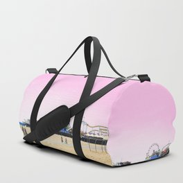 Santa Monica Pier with Ferries Wheel and Roller Coaster Against a Pink Sky Duffle Bag