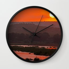 Sunrise at a river in Africa  Wall Clock