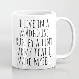 I live in a madhouse Coffee Mug