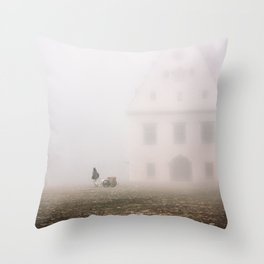 man pulling a cart on the square of Bardejov Throw Pillow