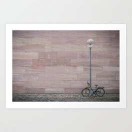 Bicycle on cobblestone covered street Art Print