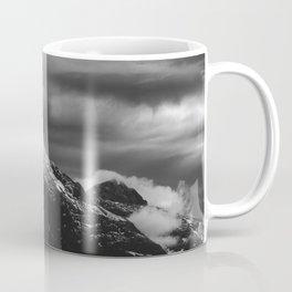 White clouds over the dark mountains Coffee Mug