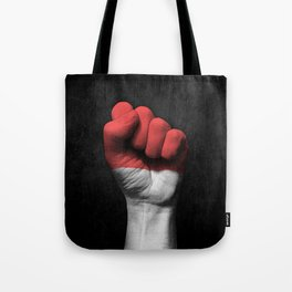 Indonesian Flag on a Raised Clenched Fist Tote Bag