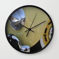 volkswagon Wall Clocks featuring Yellow Love Bug by wildVWflower
