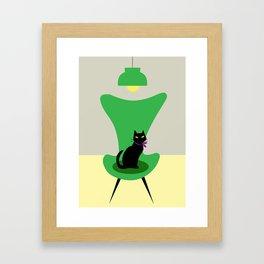 Cat on a sofa in green Framed Art Print