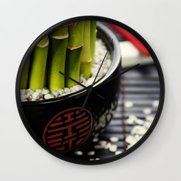 Chopsticks and a lucky bamboo plant Wall Clock