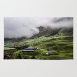 Luscious green mountain views in Switzerland Rug