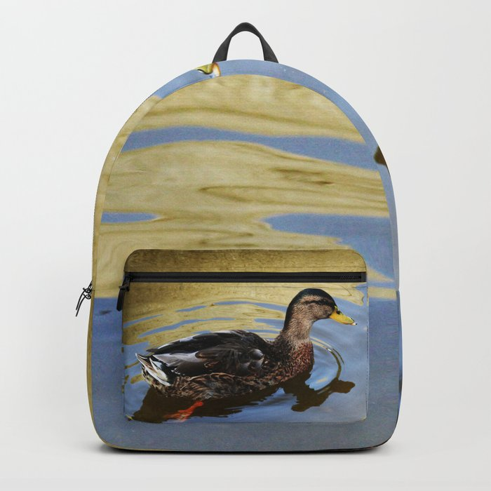 Duck swimming in a golden lake Backpack