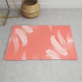 Palm leaves on living coral Rug