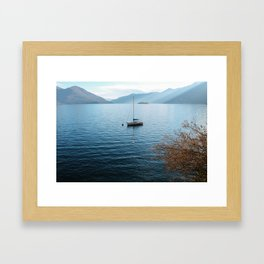 Sailboat Floats in Lake Maggiore Framed Art Print
