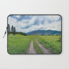 Alpine steppe in the background of snowy mountains Laptop Sleeve