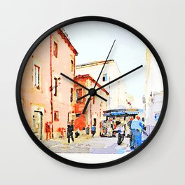 Teramo: foreshortening with red buildings and newspaper kiosk Wall Clock