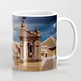 Old Spanish church on the hill. Numerous cottony clouds cover the sky. Coffee Mug