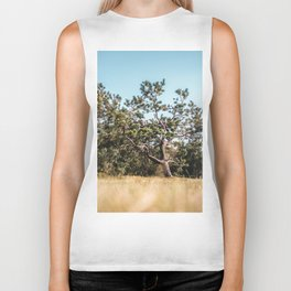 She daydreamed of surreal worlds and they vanished into matter. Biker Tank