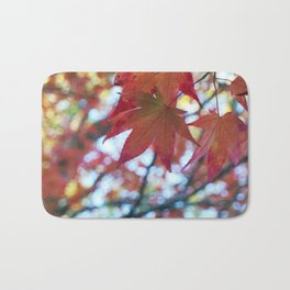 red maple leaves and bokeh Bath Mat