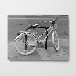 Vintage bike locked on a bike rack. Metal Print