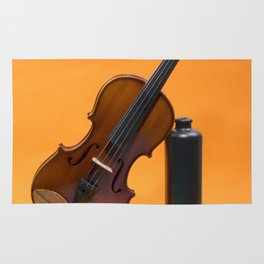 Still-life with a violin and a dark bottle Rug