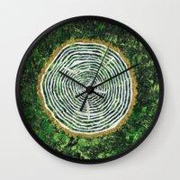 tree rings Wall Clocks featuring Tree Rings by Zoë Miller
