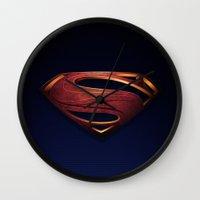 man of steel Wall Clocks featuring Man of Steel by Fortale