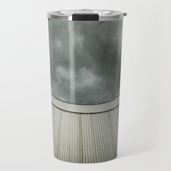 Building with metal covering against stormy sky Travel Mug