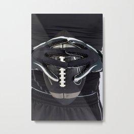 Black gloved hands holding a black American Football Metal Print