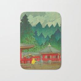 Vintage Japanese Woodblock Print Rainy Day At The Shinto Shrine Tall Pine trees Yellow Rain Coat Bath Mat