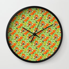 A pair of foxes on field. One stretches, the other licks his paw.  Wall Clock