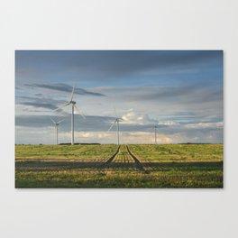 Wind turbines on a Windfarm at sunset. Norfolk, UK. Canvas Print