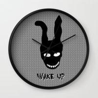 donnie darko Wall Clocks featuring Donnie Darko Wake Up by Grace