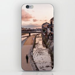 Evening walk along the Kamo River in Kyoto iPhone Skin