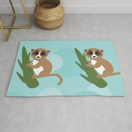 pattern - lemur on green branch on blue background Rug